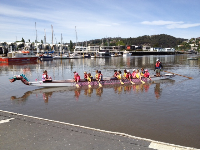 Riverside High School students and DANTI paddlers on the Tamar Tittilator on the North Esk River